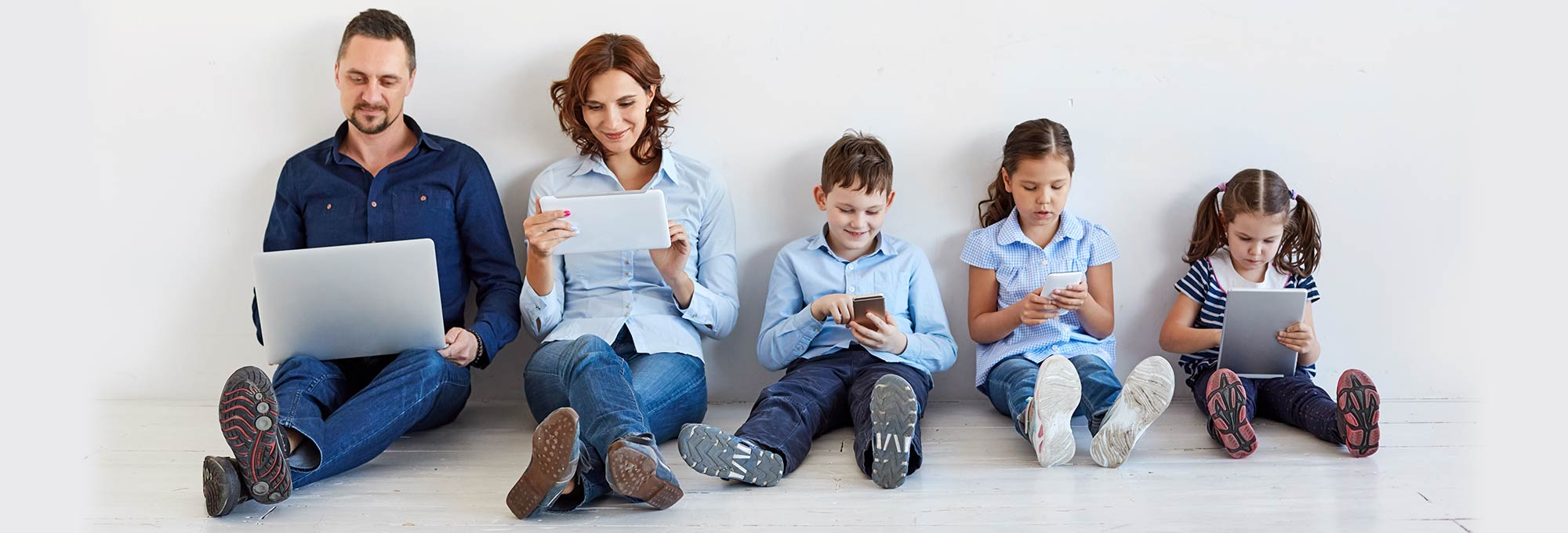 Family using the internet on five different devices